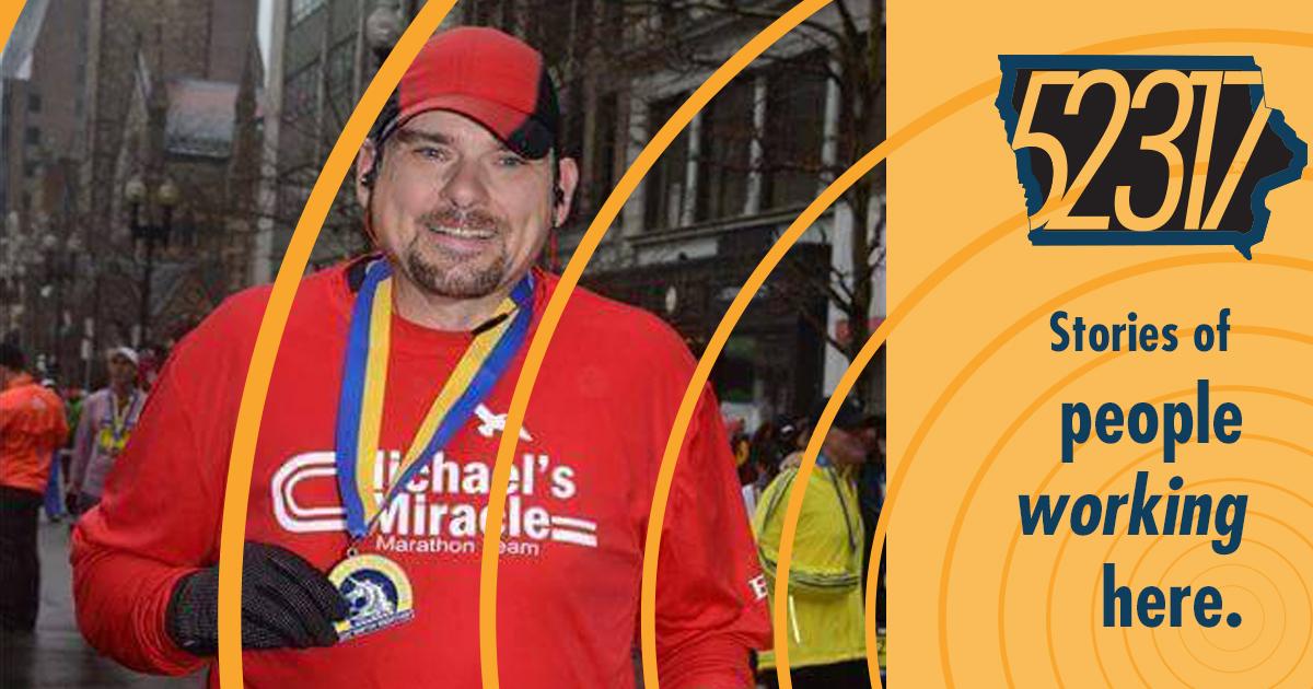 runner displaying running medal