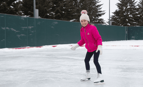 A child ice skates in winter outdoors
