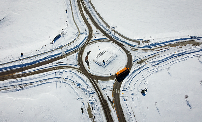 A snowy roundabout from above.