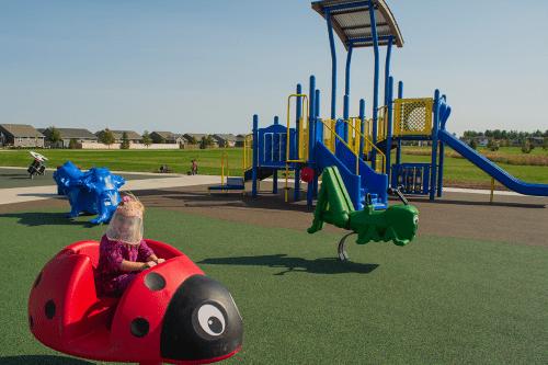 kid wearing face mask at park