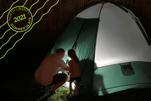 daughter and dad next to tent