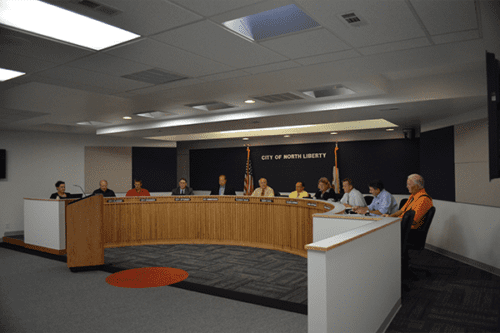 A meeting at the North Liberty City Council Chambers