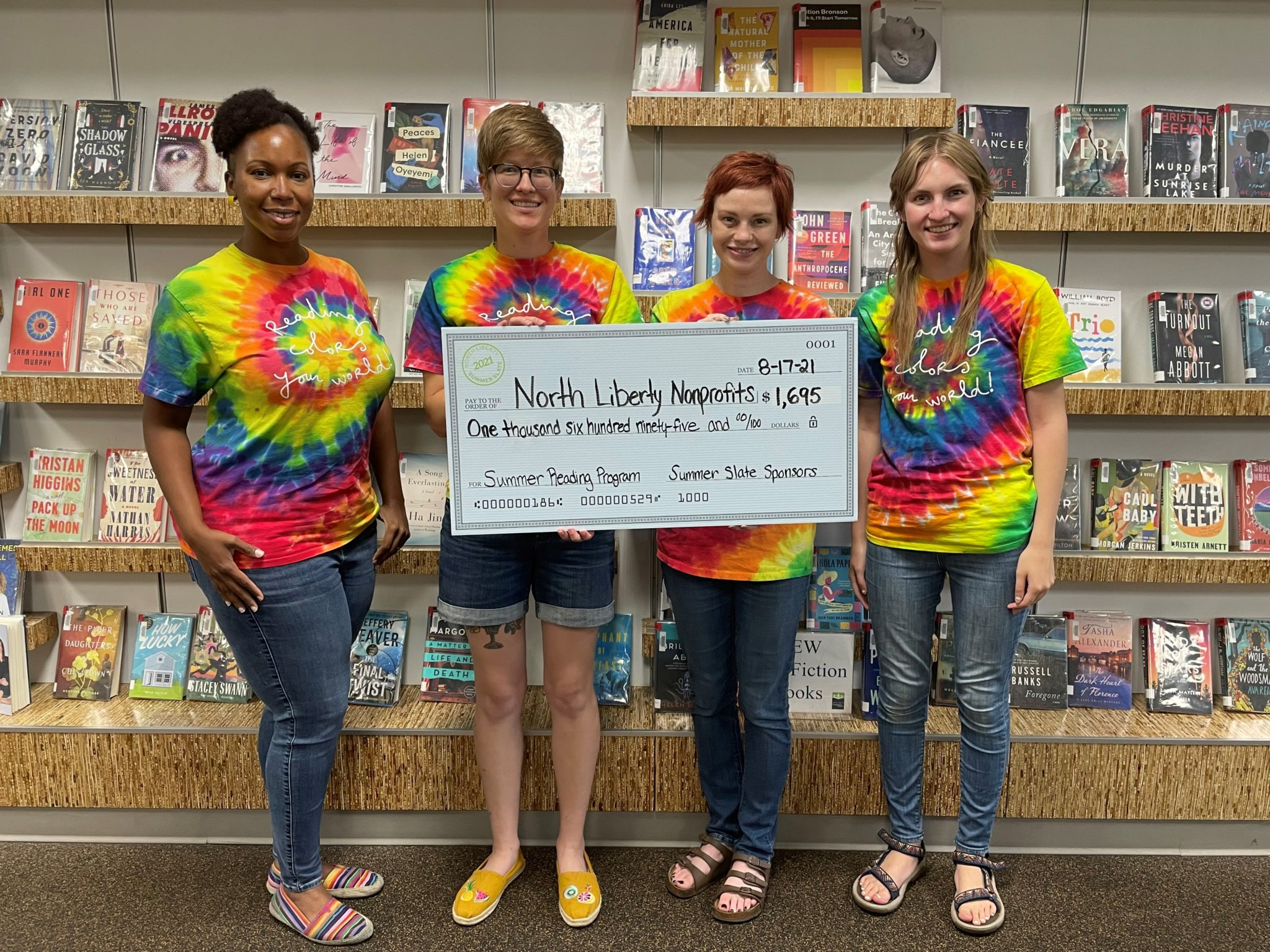 Librarians holding donation check
